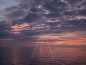 Sunset over the Aegean near Santorini